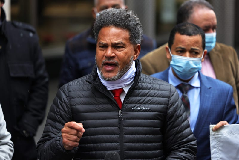 Fernando Mateo (C) speaks during a press conference in front of the Pfizer headquarters in Manhattan on December 09, 2020 in New York City