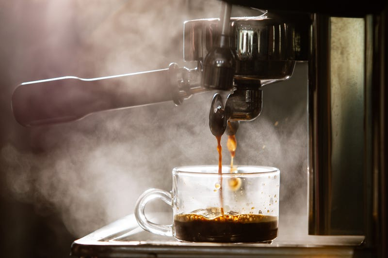 Coffee pouring into a cup.
