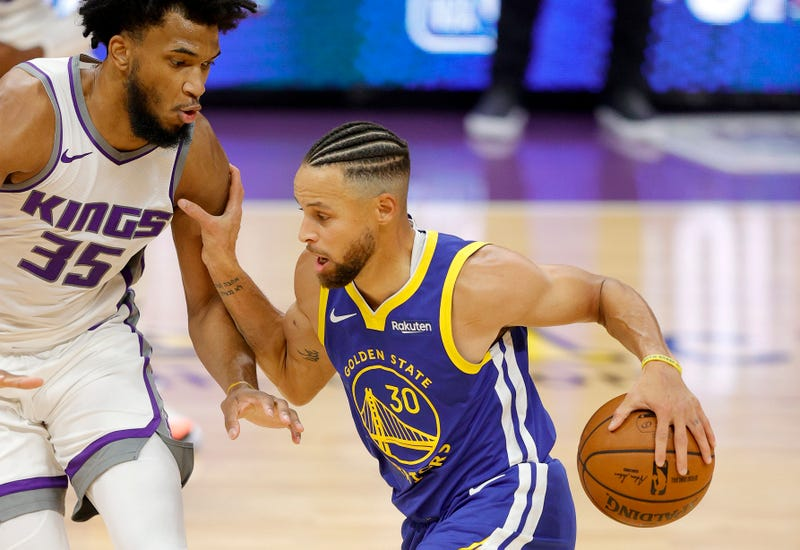 Warriors guard Stephen Curry challenges Kings defender Marvin Bagley