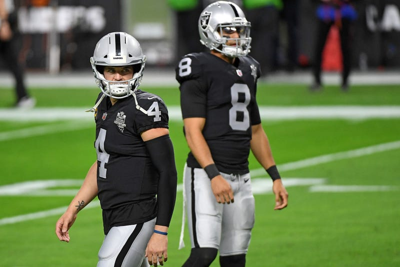 Derek Carr and Marcus Mariota warm up prior to a game.