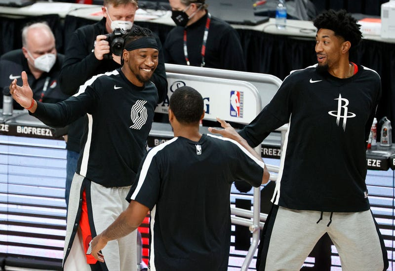 Robert Covington greets Christian Wood and another Rocket prior to a game.
