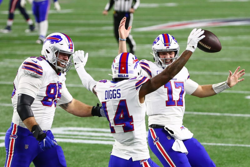 Stefon Diggs celebrates a touchdown with Josh Allen and Lee Smith.