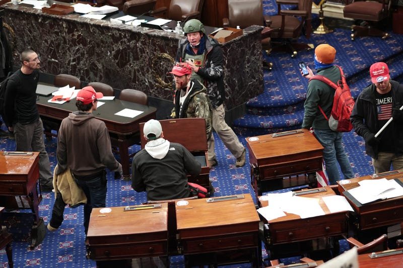 Protesters enter the Senate Chamber on January 06, 2021 in Washington, DC. Congress held a joint session to ratify President-elect Joe Biden's 306-232 Electoral College win over President Donald Trump.