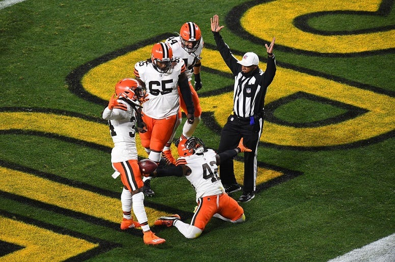 Karl Joseph #42 of the Cleveland Browns celebrates a touchdown during the first half of the AFC Wild Card Playoff game against the Pittsburgh Steelers