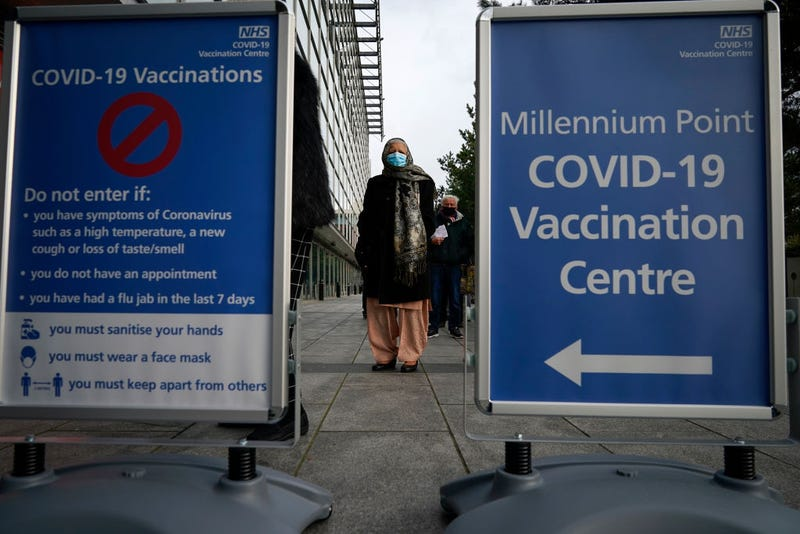 People queue outside the mass NHS Covid-19 vaccine centre that has been set up