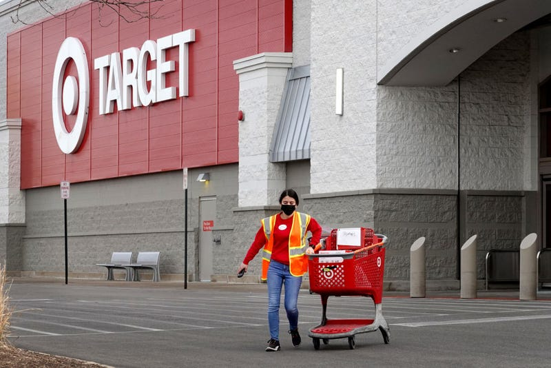 A worker brings merchandise to a customer who opted for pick-up service at a Target store on January 13, 2021 in Chicago, Illinois.