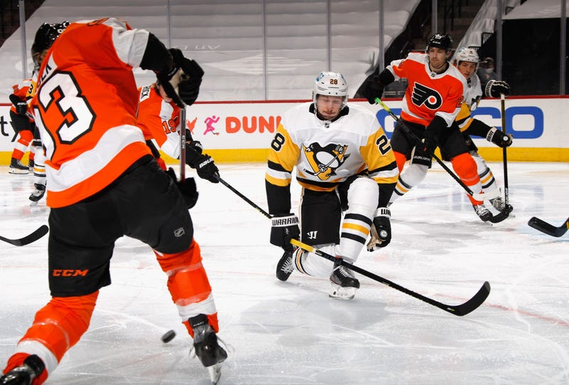 Marcus Pettersson #28 of the Pittsburgh Penguins blocks a third period shot by Jakub Voracek #93
