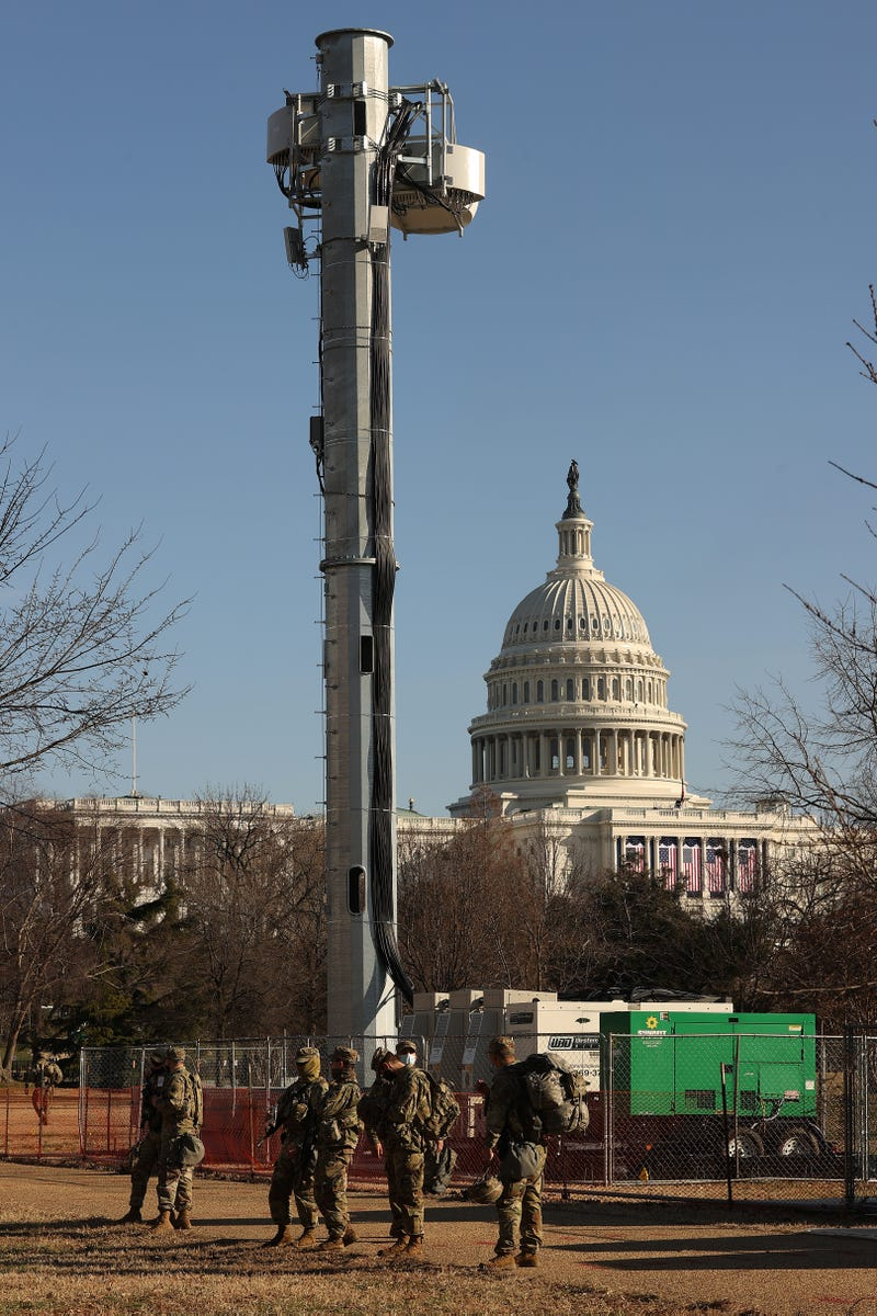 National Guard troops stand watch at the base of a communications tower on the West Front of the U.S. Capitol the day after the House of Representatives voted to impeach President Donald Trump for the second time January 14, 2021 in Washington, DC. Thousands of National Guard troops have been activated to protect the nation's capital against threats surrounding President-elect Joe Biden's inauguration and to prevent a repeat of last week's deadly insurrection at the U.S. Capitol.