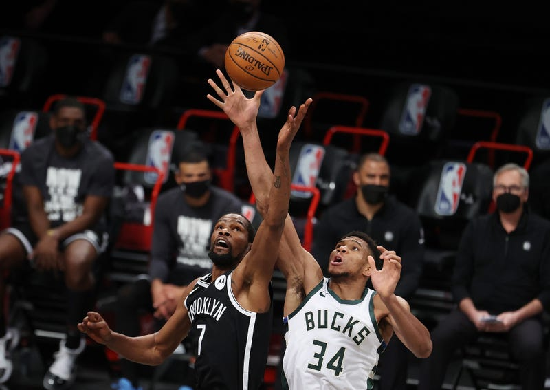 A jump-ball between Nets star Kevin Durant and Bucks' Giannis Antetokounmpo.