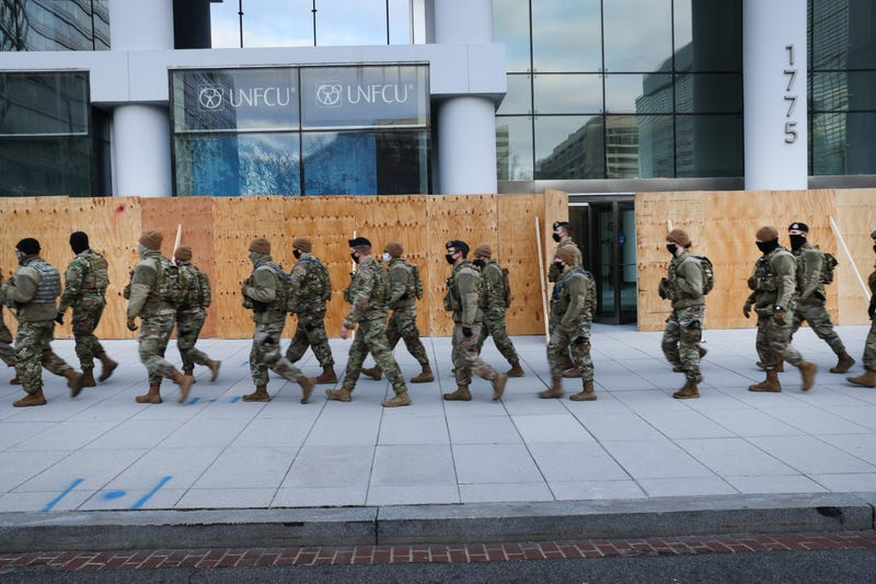 Members of the National Guard patrol the streets as businesses are boarded up on January 19, 2021 in Washington, DC.