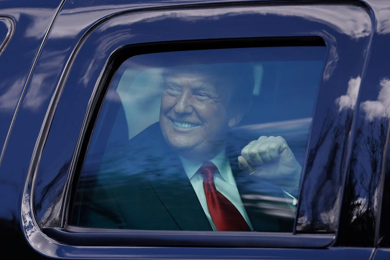 President Donald Trump waves to supporters in West Palm Beach, Florida.
