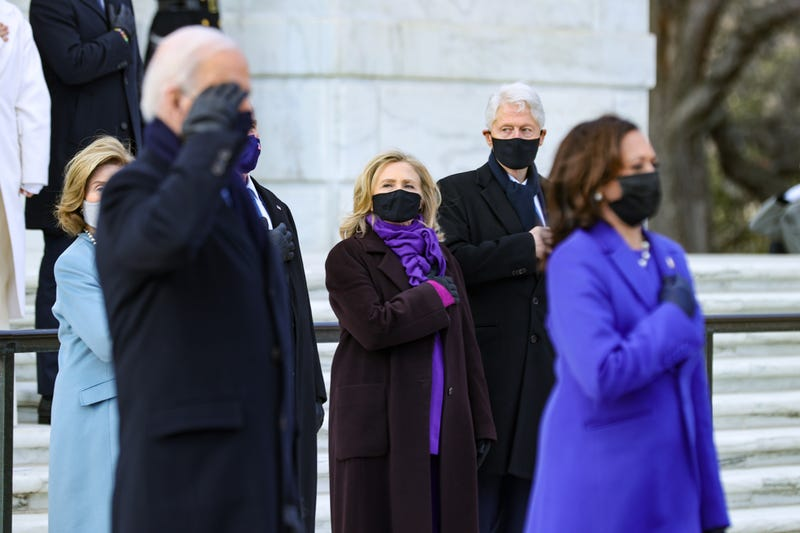U.S. President Joe Biden and Vice President Kamala Harris attend a wreath-laying ceremony at Arlington National Cemetery's Tomb of the Unknown Soldier after the 59th Presidential Inauguration ceremony at the U.S. Capitol, as former U.S. President George W. Bush and Laura Bush, and former U.S. President Bill Clinton and former Secretary of State Hillary Clinton look on, January 20, 2021 in Arlington, Virginia. During today's inauguration ceremony Joe Biden becomes the 46th president of the United States.