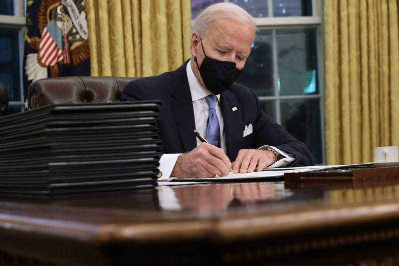 U.S. President Joe Biden prepares to sign a series of executive orders at the Resolute Desk in the Oval Office just hours after his inauguration on January 20, 2021 in Washington, DC. Biden became the 46th president of the United States earlier today during the ceremony at the U.S. Capitol.