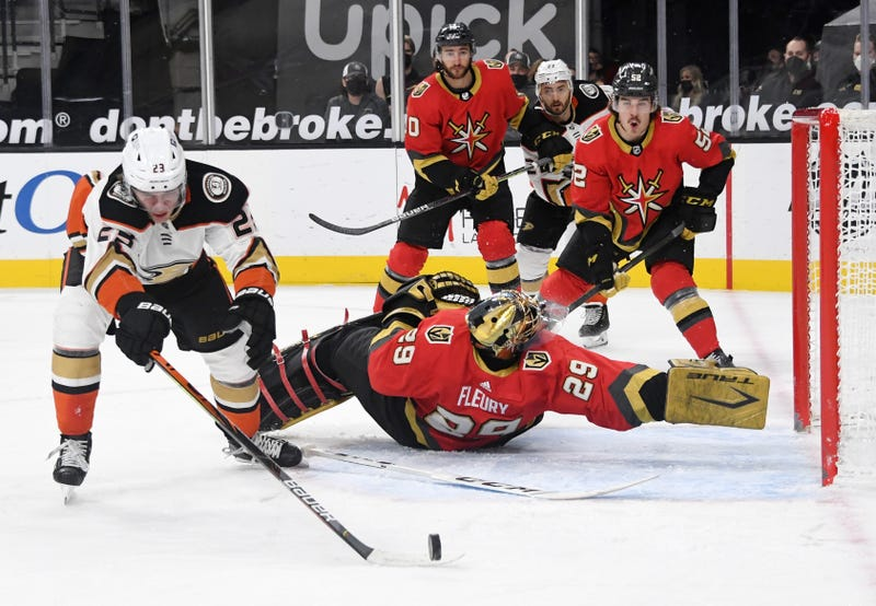 Andre Fleury #29 of the Vegas Golden Knights flips on his back as he defends the net against Sam Steel #23 of the Anaheim Ducks in the first period of their game at T-Mobile Arena on February 9, 2021 in Las Vegas, Nevada.