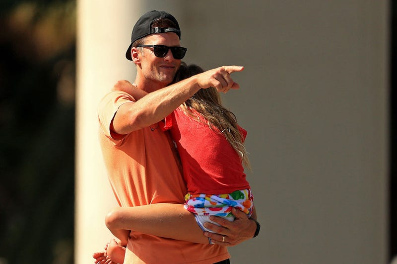 Tom Brady #12 of the Tampa Bay Buccaneers hugs his daughter Vivian celebrating their Super Bowl LV victory during a boat parade through the city on February 10, 2021 in Tampa, Florida.