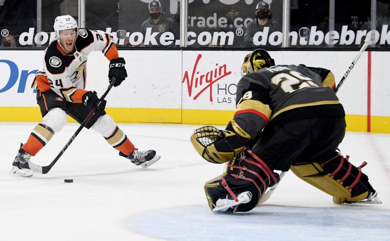 Carter Rowney #24 of the Anaheim Ducks takes a shot against Marc-Andre Fleury #29 of the Vegas Golden Knights in the third period of their game at T-Mobile Arena on February 11, 2021 in Las Vegas, Nevada.