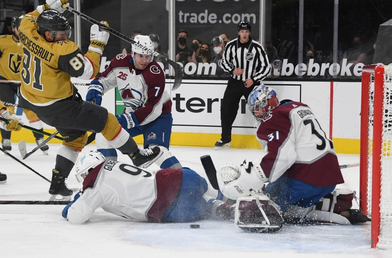 Philipp Grubauer #31 of the Colorado Avalanche makes a save against Jonathan Marchessault #81 of the Vegas Golden Knights as Dennis Gilbert #9 of the Avalanche defends in the second period of their game at T-Mobile Arena on February 14, 2021 in Las Vegas, Nevada.