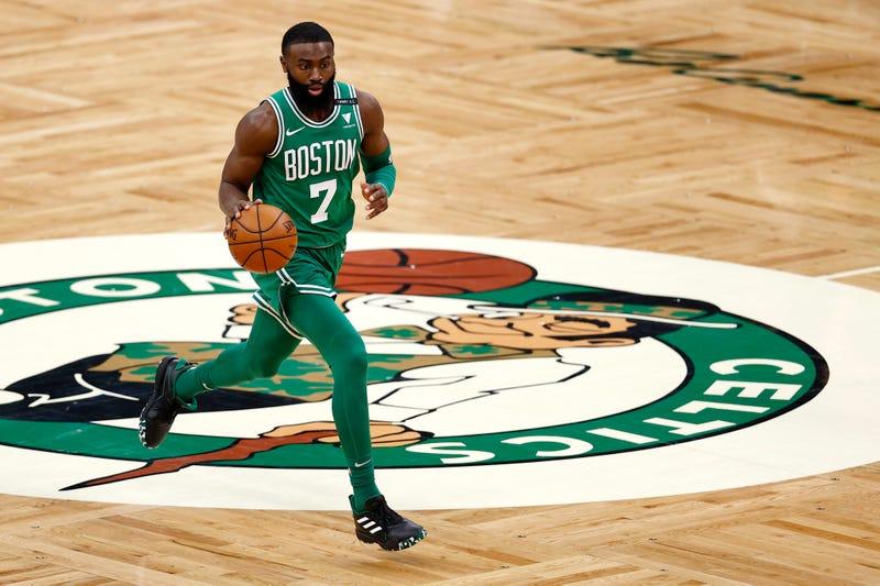 Celtics guard Jaylen Brown dribbling up the court.