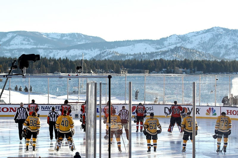 The Bruins and Flyers line up for the national anthem with Lake Tahoe in the background
