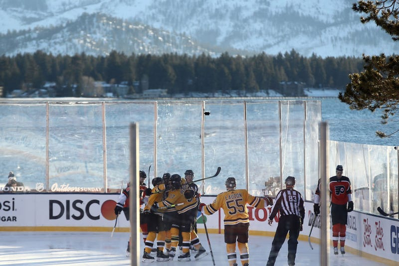 The Bruins celebrate a first-period goal with Lake Tahoe in the background