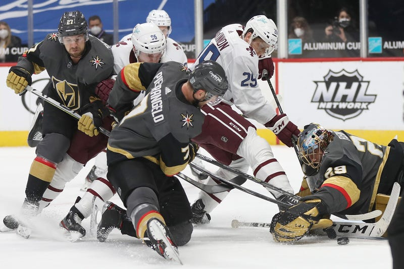 Goalie Marc-Andre Fleury #29 of the Las Vegas Knights makes a save against Nathan MacKinnon #29 of the Colorado Avalanche in the second period at Ball Arena on February 22, 2021 in Denver, Colorado.