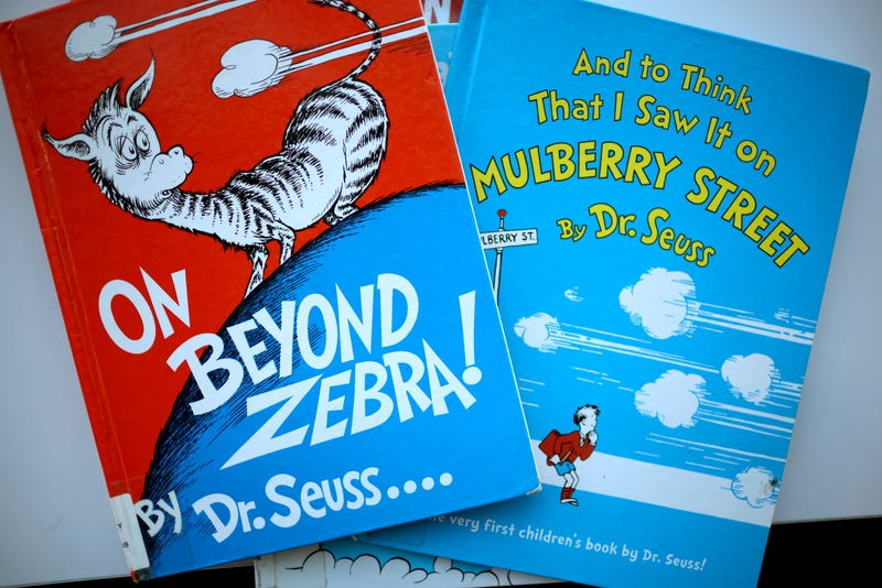 """Books by Theodor Seuss Geisel, aka Dr. Seuss, including """"On Beyond Zebra!"""" and """"And to Think That I Saw it on Mulberry Street,"""" are offered for loan at the Chinatown Branch of the Chicago Public Library on March 02, 2021 in Chicago, Illinois."""