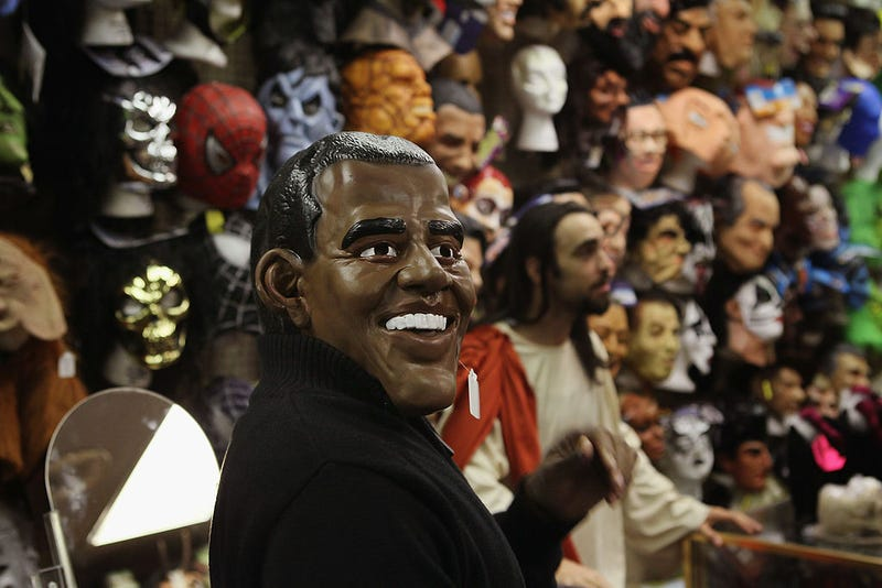 A customer tries on a Barack Obama Halloween mask at Fantasy Costumes on October 28, 2011 in Chicago, Illinois.