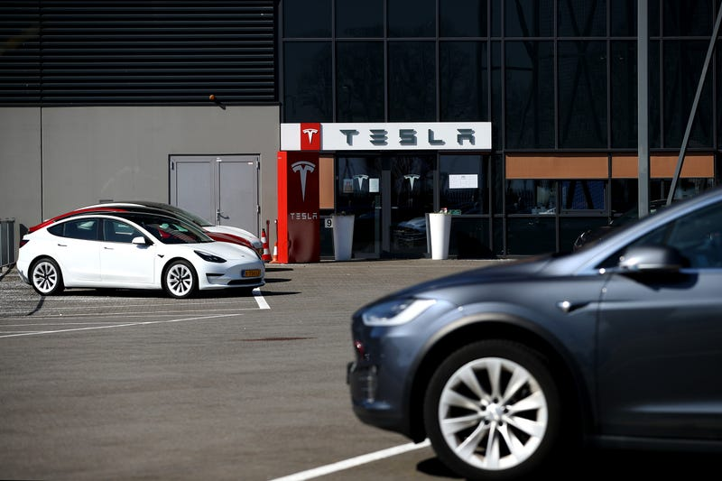 Models S and X sit outside a Tesla Assembly plant.