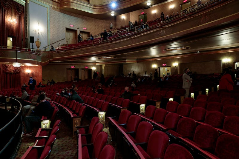 Attendees take their seats for a special NY PopsUp performance for frontline workers at the St. James Theatre on April 03, 2021 in New York City