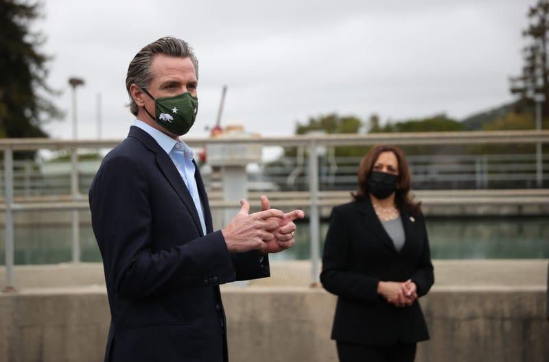 U.S. Vice President Kamala Harris (R) looks on as California Gov. Gavin Newsom speaks while touring the Upper San Leandro Water Treatment Plant on April 5, 2021 in Oakland, California.