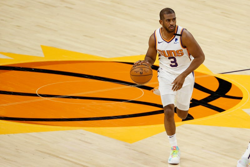 Phoenix Suns veteran guard Chris Paul dribbles up the court.