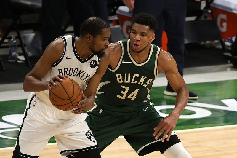 Bucks star Giannis Antetokounmpo guards Nets star Kevin Durant.