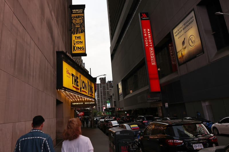 File photo: People walk through the Theater District in Manhattan earlier this year
