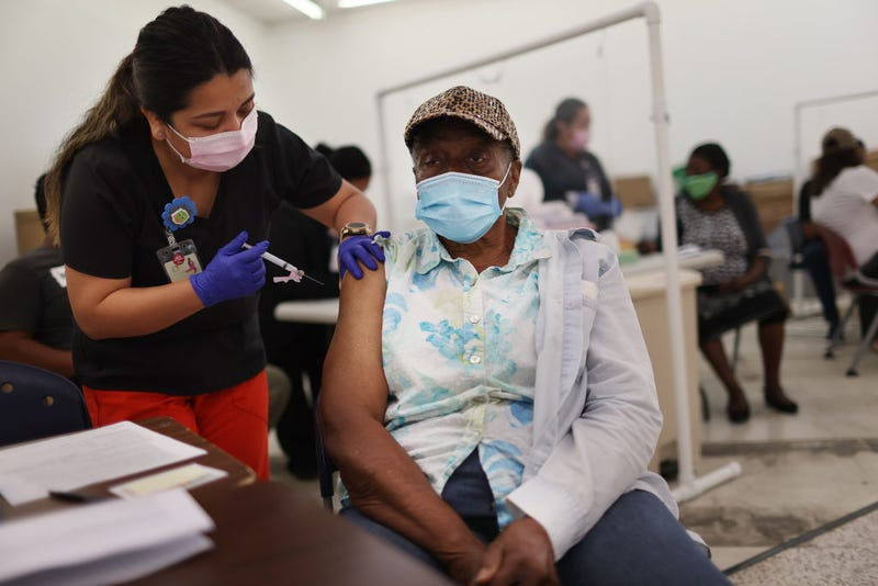Anna Mendez, LPN, administers a Moderna COVID-19 vaccine to Vern Henderson at a clinic set up by Healthcare Network on May 20, 2021 in Immokalee, Florida. The Healthcare Network set up the vaccination site for particularly hard-to-reach populations, including seasonal farmworkers and people with limited proficiency in English. Immokalee sees a large seasonal surge of farmworkers for the winter harvest