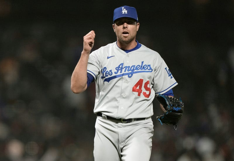 Blake Treinen #49 of the Los Angeles Dodgers reacts after getting the final out of the game against the San Francisco Giants in the ninth inning at Oracle Park on May 21, 2021 in San Francisco, California.