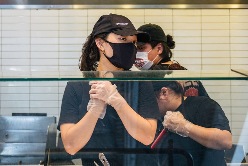 Employees are shown working at a Chipotle Mexican Grill on June 09, 2021 in Houston, Texas.