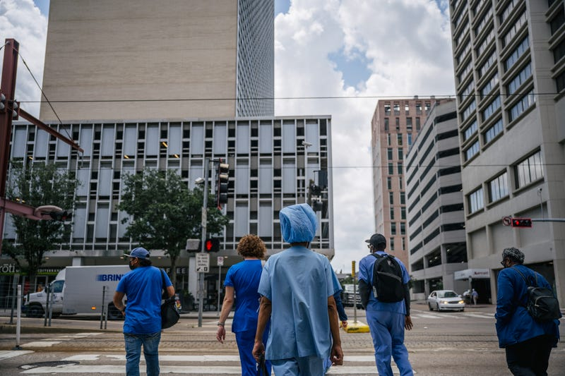 Medical workers outside Houston Methodist Hospital.