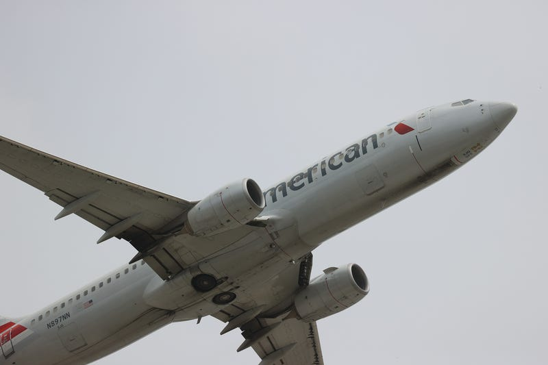 An American Airlines plane takes off at Miami International Airport.