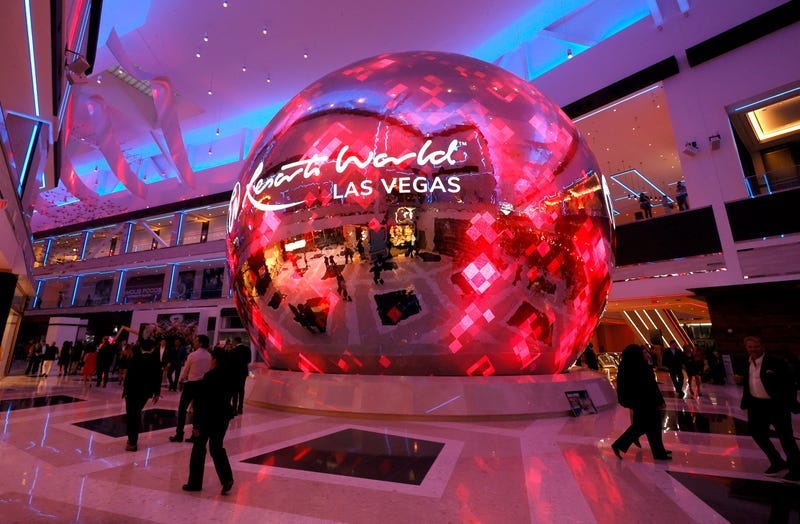 Guests walk by a digital sphere during the opening of Resorts World Las Vegas on June 24, 2021 in Las Vegas, Nevada.
