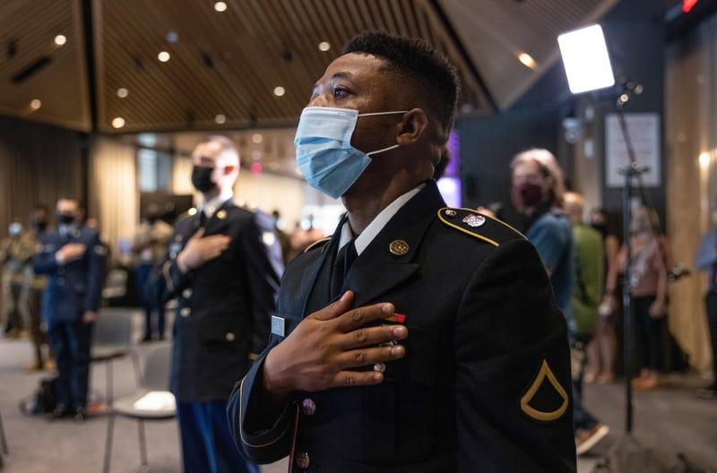 U.S. soldiers take the oath of allegiance wearing masks.