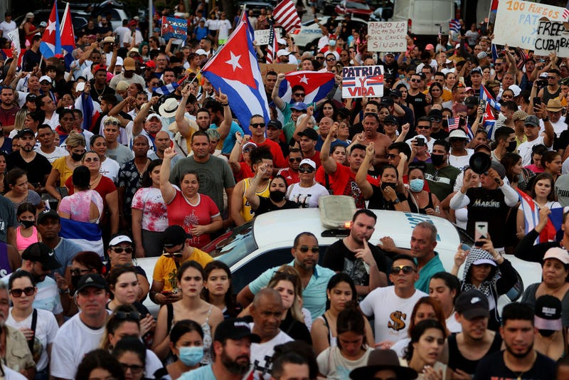 Protesters gather in front of the Versailles restaurant to show support for the people in Cuba who have taken to the streets there to protest on July 11, 2021 in Miami, Florida. Thousands of Cubans took to the streets across the country to protest pandemic restrictions, the pace of Covid-19 vaccinations and the Cuban government.