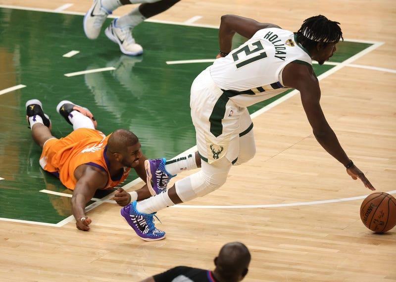 Suns guard Chris Paul and Bucks guard Jrue Holiday.