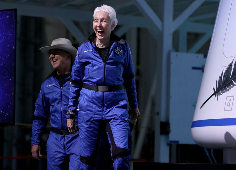 Blue Origin's New Shepard crew (L-R) Jeff Bezos and Wally Funk arrive for a press conference after flying into space in the Blue Origin New Shepard rocket on July 20, 2021 in Van Horn, Texas.