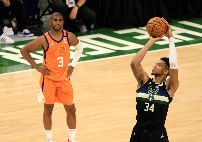 Suns star Chris Paul and Bucks star Giannis Antetokounmpo.
