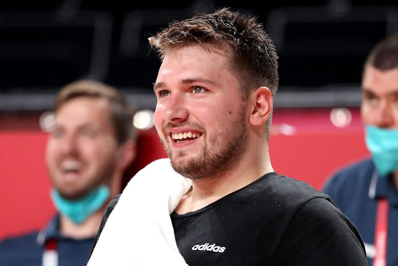 Luka Doncic #77 of Team Slovenia smiles from the bench against Japan during the second half of a Men's Preliminary Round Group C game on day six of the Tokyo 2020 Olympic Games at Saitama Super Arena on July 29, 2021 in Saitama, Japan.