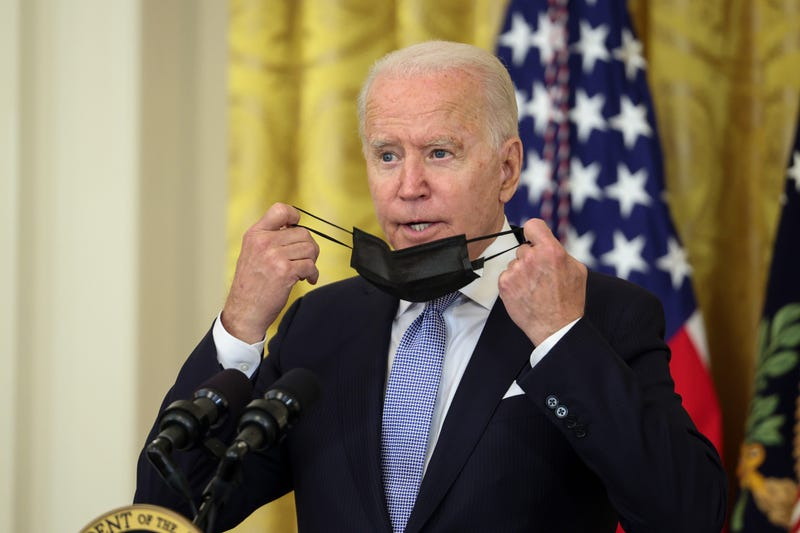 U.S. President Joe Biden takes off his face mask after arriving to deliver remarks in the East Room of the White House on July 29, 2021 in Washington, DC. President Biden spoke on his administration's effort to get more Americans vaccinated and plan to combat the spread of the Delta variant.