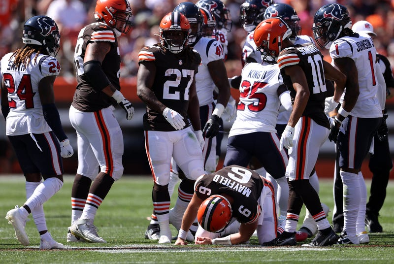 Quarterback Baker Mayfield #6 of the Cleveland Browns is on the ground after being hit in the first half in the game against the Houston Texans at FirstEnergy Stadium on September 19, 2021 in Cleveland, Ohio