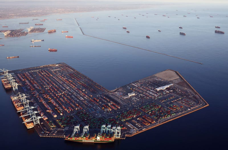 In an aerial view, container ships (Top R) are anchored by the ports of Long Beach and Los Angeles as they wait to offload on September 20, 2021 near Los Angeles, California. Amid a record-high demand for imported goods and a shortage of shipping containers and truckers, the twin ports are currently seeing unprecedented congestion. On September 17, there were a record total of 147 ships, 95 of which were container ships, in the twin ports, which move about 40 percent of all cargo containers entering the U.S. (Photo by Mario Tama/Getty Images)