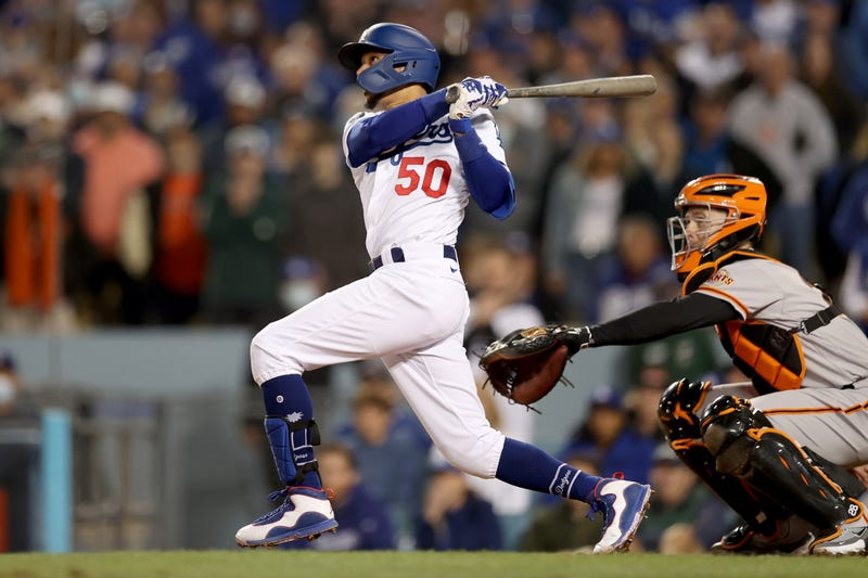 Mookie Betts #50 of the Los Angeles Dodgers watches his RBI sacrifice fly out against the San Francisco Giants during the fifth inning in game 4 of the National League Division Series at Dodger Stadium on October 12, 2021 in Los Angeles, California.