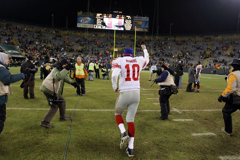 Eli Manning celebrates after the Giants beat the Green Bay Packers in the 2011 NFC title game